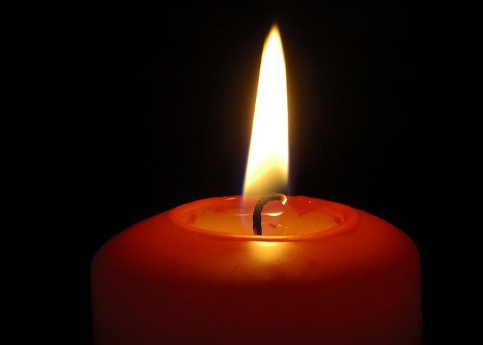 Candle Greeting Card featuring the photograph Red Candle Burning by Matthias Hauser