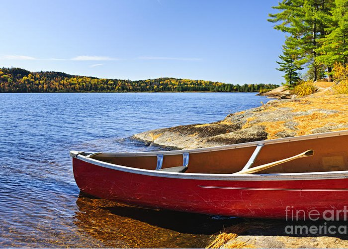 Canoe Greeting Card featuring the photograph Red Canoe On Shore by Elena Elisseeva