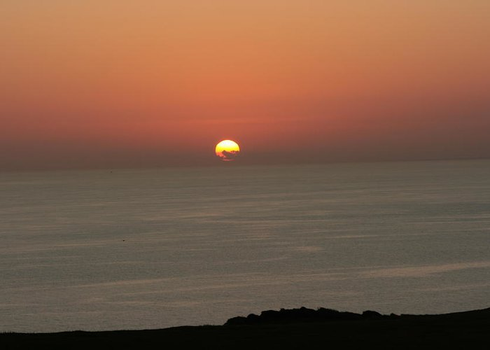 Red Sunset Over Sea Greeting Card featuring the photograph Red Sunset Over Sea by Gordon Auld