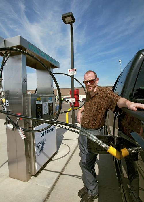 Human Greeting Card featuring the photograph Refuelling A Natural Gas Vehicle by Jim West
