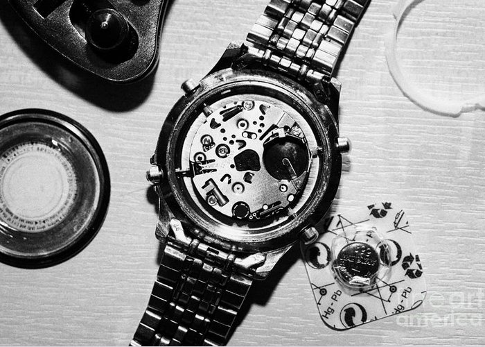 Replace Greeting Card featuring the photograph Replacing The Battery In A Metal Band Wrist Watch by Joe Fox