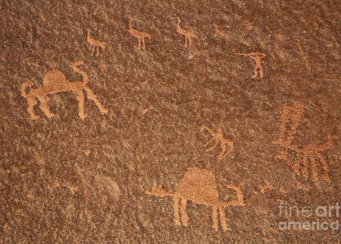 Petroglyph Greeting Card featuring the photograph Rock Art At Wadi Rum In Jordan by Robert Preston