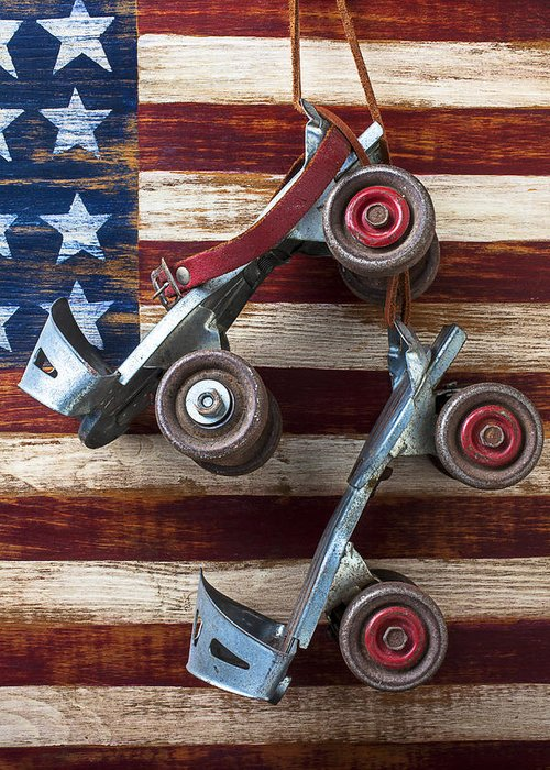 Old Roller Skates Greeting Card featuring the photograph Rollar Skates With Wooden Flag by Garry Gay