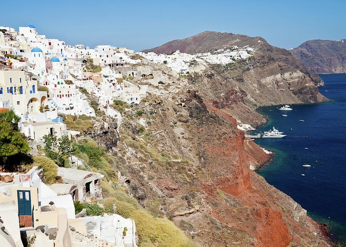 Tranquility Greeting Card featuring the photograph Rows Of Houses Perch On Cliff In Oia by Melissa Tse
