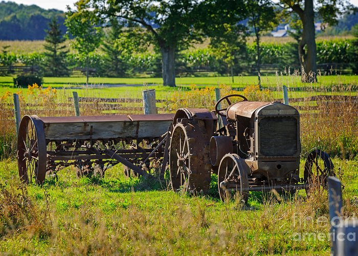 Rusty Greeting Card featuring the photograph Rusty Old Mccormick Deering Tractor by Louise Heusinkveld