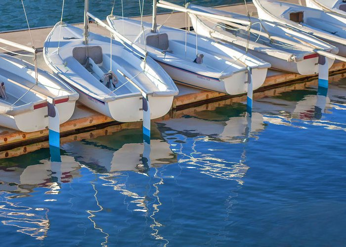 Boats Greeting Card featuring the painting Sailboats And Dock by Cliff Wassmann