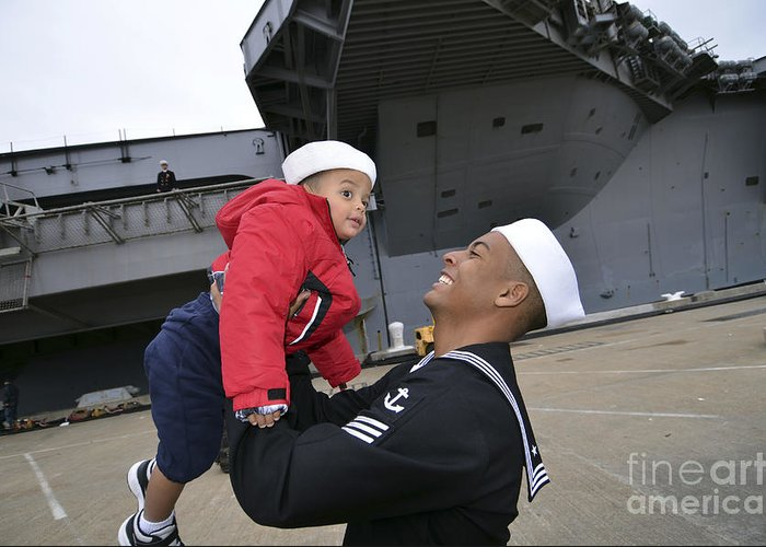 Happiness Greeting Card featuring the photograph Seaman Greets His Son by Stocktrek Images