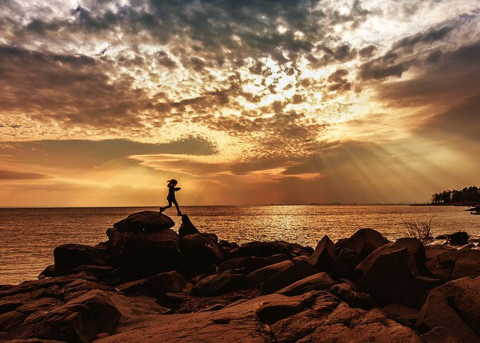 shine On Me chasing Light child In Landscape Children Light Silhouette lake Superior north Shore brighton Beach rock Scrambling Sunset sun Rays Rays Girl capture Minnesota greeting Cards mary Amerman Greeting Card featuring the photograph Shine On Me by Mary Amerman