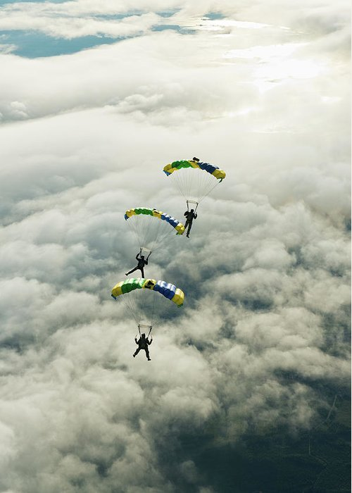 Young Men Greeting Card featuring the photograph Skydivers In Mid-air by Johner Images