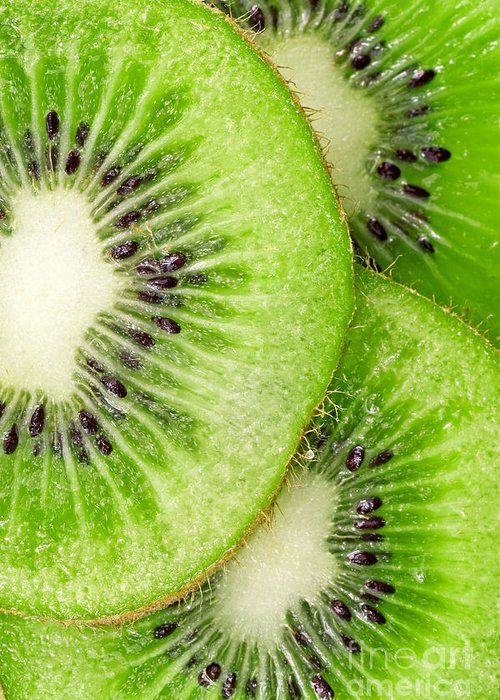 Kiwi Greeting Card featuring the photograph Slices Of Juicy Kiwi Fruit by G J