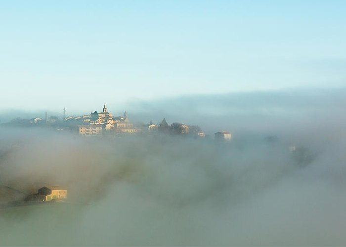 Scenics Greeting Card featuring the photograph Small Italian Village In The Fog by Deimagine