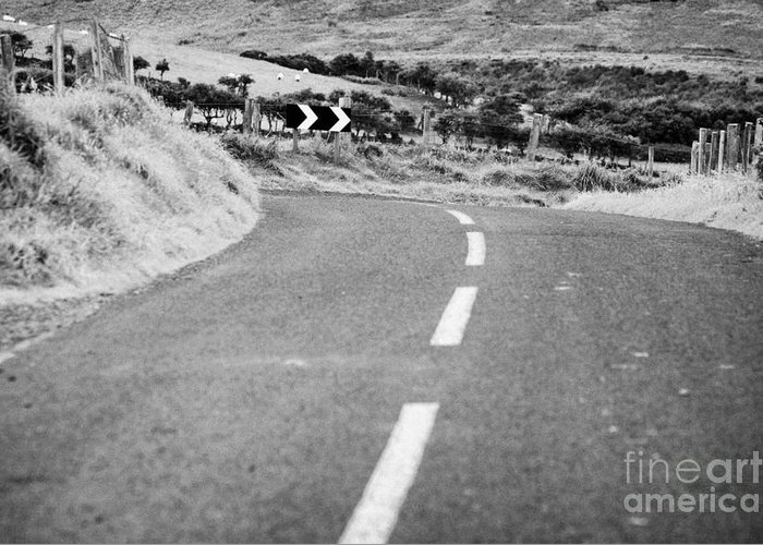 Northern Greeting Card featuring the photograph Small Narrow Country Road Leading To Dangerous Bend In County Antrim Northern Ireland by Joe Fox