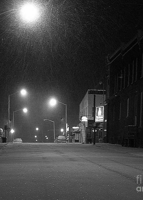Black And White Photography Greeting Card featuring the photograph Snowing On W. Fourth St. by Julie Dant