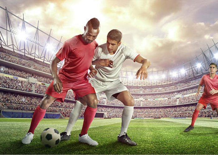 Soccer Uniform Greeting Card featuring the photograph Soccer Player Tackling Ball In Stadium by Dmytro Aksonov