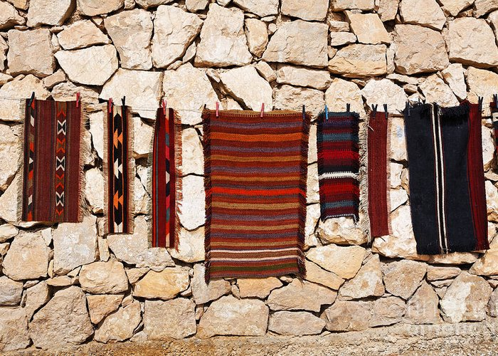 Rug Greeting Card featuring the photograph Souvenir Rugs For Sale At Wadi Mujib Jordan by Robert Preston