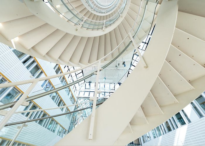 Steps Greeting Card featuring the photograph Spiral Staircase Inside Office Complex by Blurra