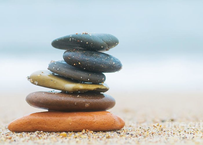 Stone Greeting Card featuring the photograph Stack Of Beach Stones On Sand by Michal Bednarek