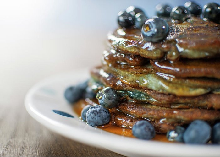 Unhealthy Eating Greeting Card featuring the photograph Still Life Of Blueberry Pancakes With by Matt Walford