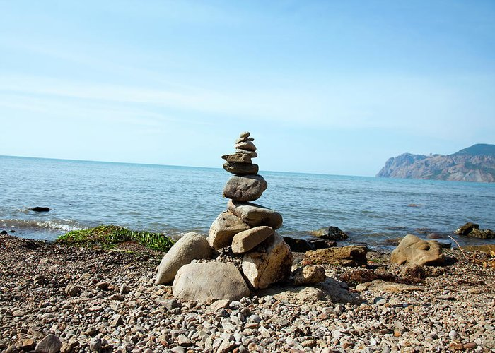 Heap Greeting Card featuring the photograph Stone Tower On The Beach by Mashabuba