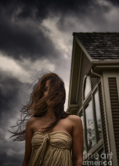 Caucasian; Woman; Lady; Female; Outside; Outdoors; Storm; Stormy; Clouds; Dark; Ominous; Wind; Windy; House; Home; Horror; Scary; Mysterious; Mystery; Foreboding; Hair; Long Hair; Brunette; Dress; Gold; Strapless; Windows; Domineering; Haunted; Scared; Terror Greeting Card featuring the photograph Storm by Margie Hurwich