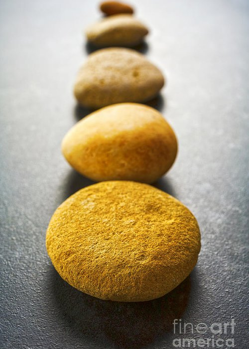 Stone Greeting Card featuring the photograph Straight Line Of Brown Pebbles On Dark Background by Colin and Linda McKie