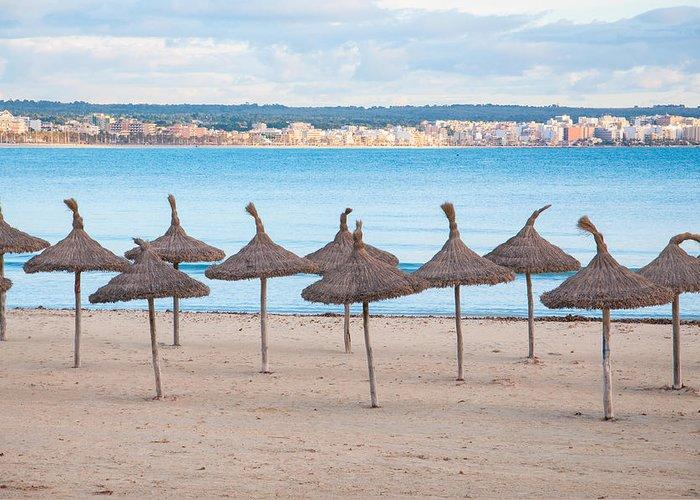 Straw Greeting Card featuring the photograph Straw Umbrellas On Empty Beach by Ingela Christina Rahm