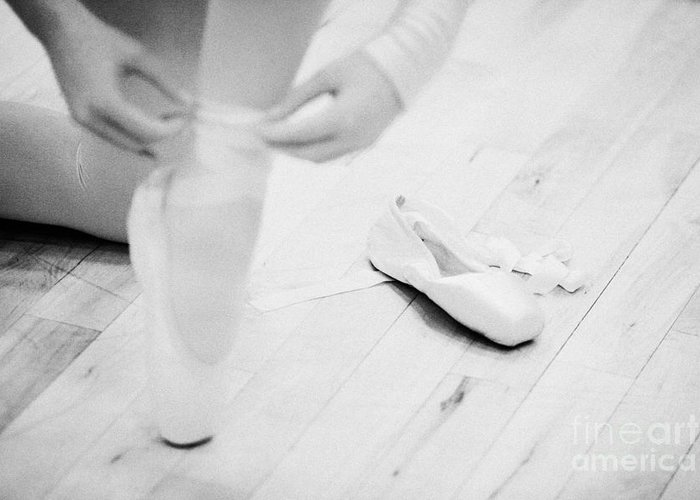 Ballet Greeting Card featuring the photograph Student Putting On Pointe Shoes At A Ballet School In The Uk by Joe Fox