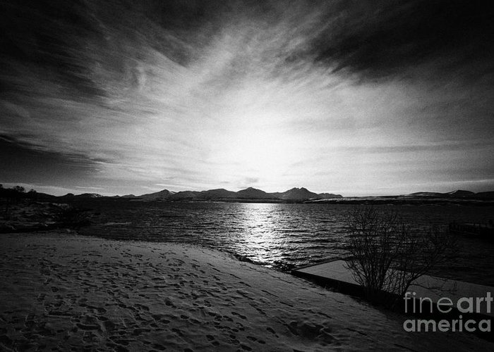 Telegrafbukta Greeting Card featuring the photograph sun setting with halo over snow covered telegrafbukta beach Tromso troms Norway europe by Joe Fox