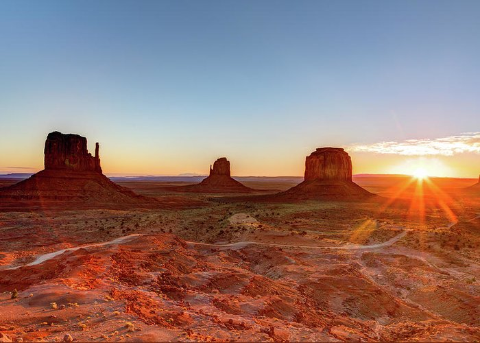 Tranquility Greeting Card featuring the photograph Sunrise On Monument Valley by Loic Lagarde