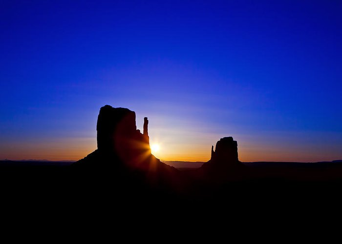 Monument Greeting Card featuring the photograph Sunrise Over Monument Valley by Susan Schmitz