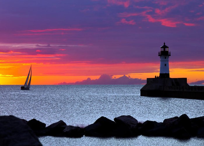 Sunrise lake Superior Sailing canal Park Lighthouse Duluth north Shore canal Park Lighthouse sail Boat Dawn Morning Magic Wow! Greeting Card featuring the photograph Sunrise Sailing by Mary Amerman