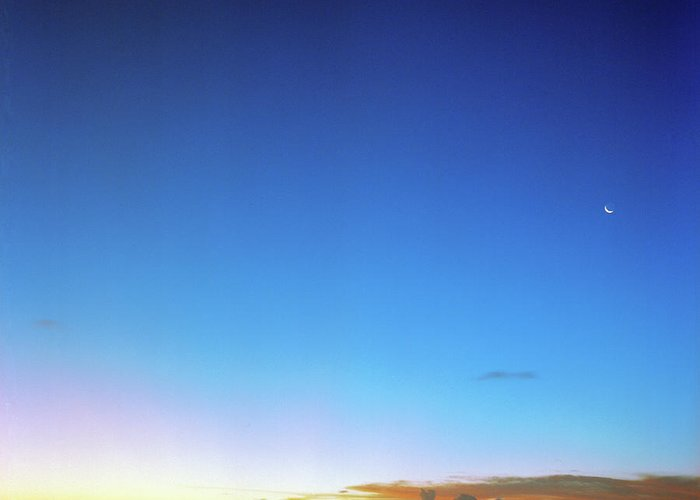 Tranquility Greeting Card featuring the photograph Sunset And Moon At Uluwatu by Vsevolod Vlasenko