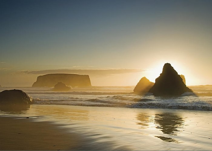 Sunset Greeting Card featuring the photograph Sunset Behind Offshore Rocks Bandon by Philippe Widling