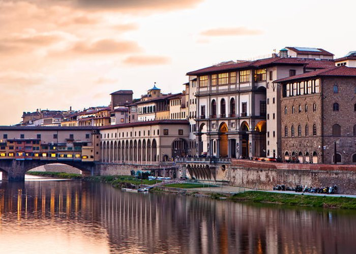 Italy Greeting Card featuring the photograph Sunset On Ponte Vecchio In Florence by Susan Schmitz