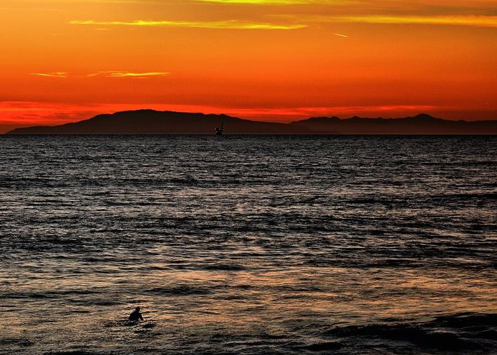 Santa Cruz Greeting Card featuring the photograph Sunset Surfer by Michael Gordon