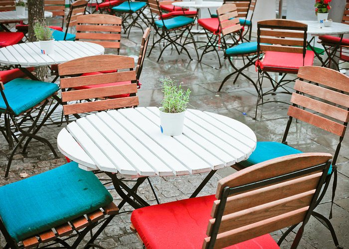 Al Fresco Greeting Card featuring the photograph Tables And Chairs by Tom Gowanlock