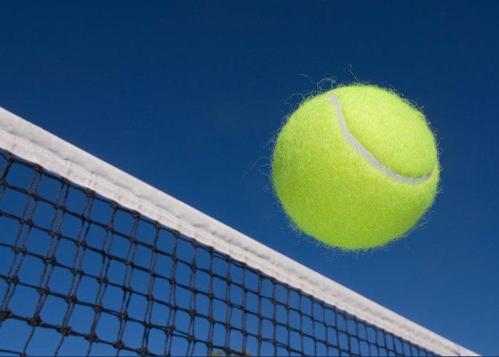 Tennis Greeting Card featuring the photograph Tennis Ball And Net by Joe Belanger