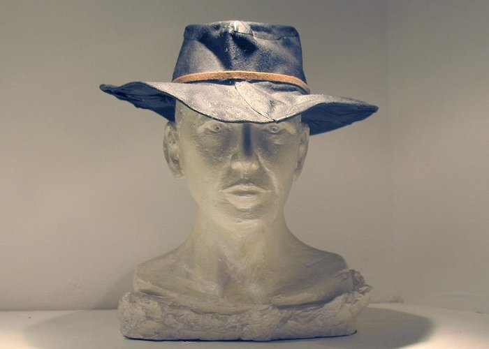 Cowboy Portrait Photograph Greeting Card featuring the sculpture The Cowboy by Flow Fitzgerald