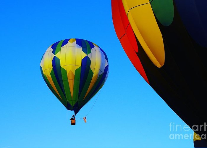 Balloons Greeting Card featuring the photograph The First One Up by Jeff Swan