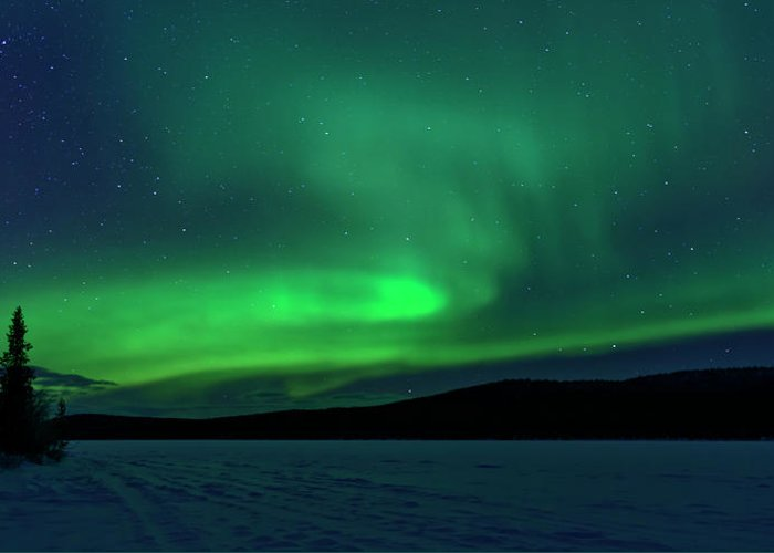 Snow Greeting Card featuring the photograph The Green Light Of The Aurora by Dave Moorhouse