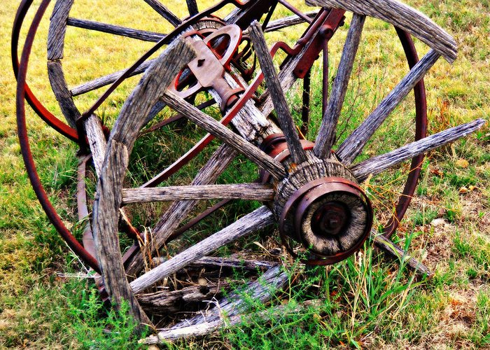 An Old Piece Of Farm Equipment Is Slowly Returning To Nature In The Ozarks Of Missouri. Greeting Card featuring the photograph Thrasher Past by Marty Koch