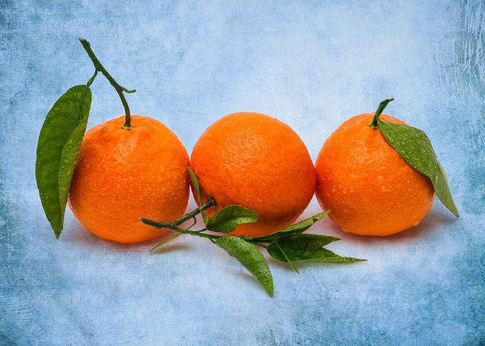 Mandarin Greeting Card featuring the photograph Three Tangerines by Alexander Senin
