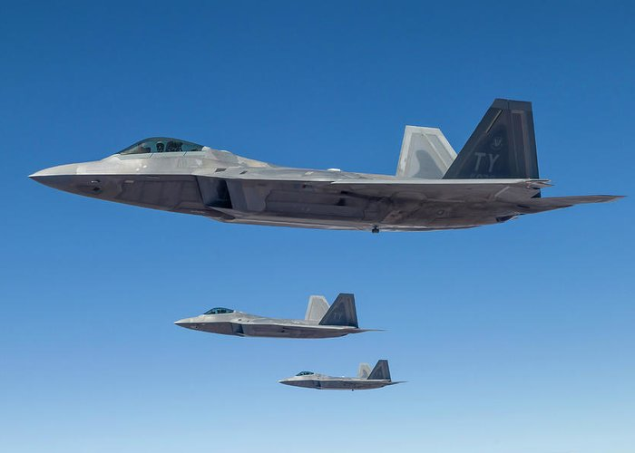 Formation Flying Greeting Card featuring the photograph Three U.s. Air Force F-22 Raptors by Rob Edgcumbe/stocktrek Images