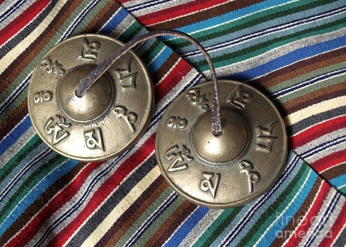 Tibetan Greeting Card featuring the photograph Tibetan Prayer Bells On Woven Scarf by Anna Lisa Yoder