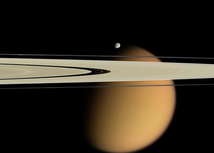 Nobody Greeting Card featuring the photograph Titan And Saturn's Rings by Nasa/jpl/space Science Institute
