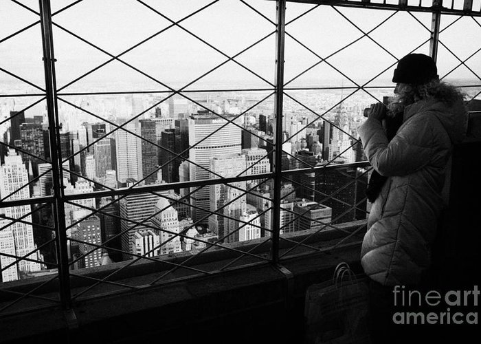 Usa Greeting Card featuring the photograph Tourist In Heavy Coat And Camera Looks At The View From Observation Deck 86th Floor Empire State by Joe Fox