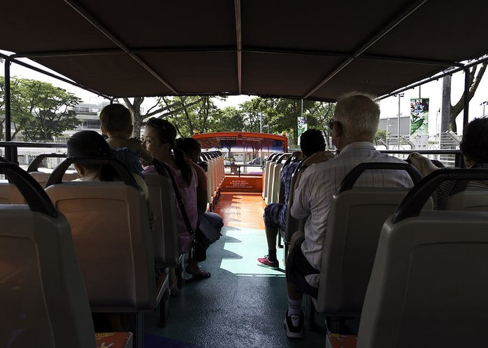 Asia Greeting Card featuring the photograph Tourists On The Sight-seeing Bus Run By The Hippo Company In Singapore by Ashish Agarwal