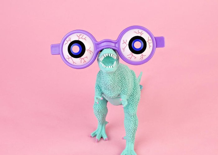 Purple Greeting Card featuring the photograph Toy Dinosaur With Spooky Glasses by Juj Winn