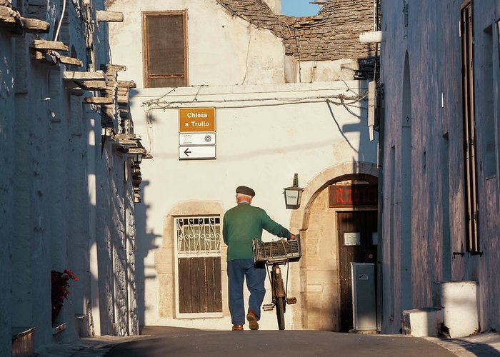 People Greeting Card featuring the photograph Trulli Houses Alberobello Apulia Puglia by Peter Adams