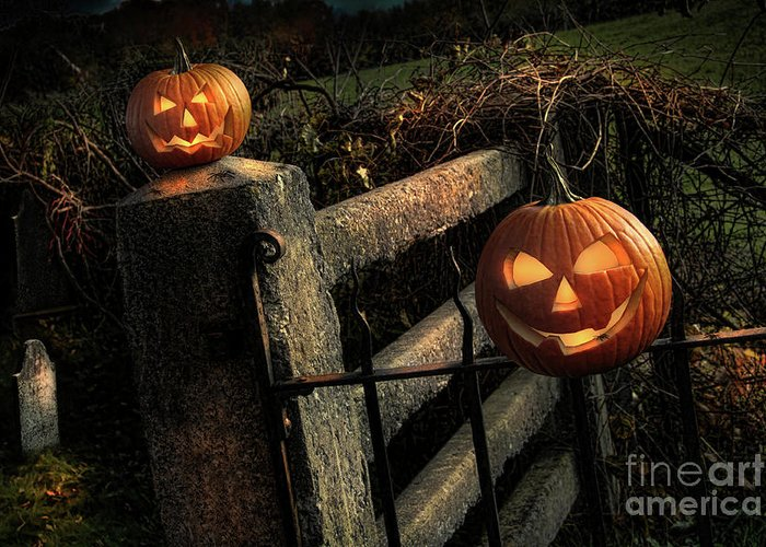 Celebration Greeting Card featuring the photograph Two Halloween Pumpkins Sitting On Fence by Sandra Cunningham
